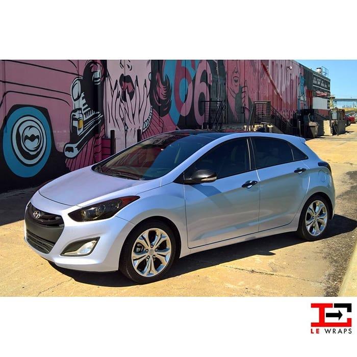Hyundai Elantra wrapped in Avery SW Gloss Quick Silver Metallic vinyl