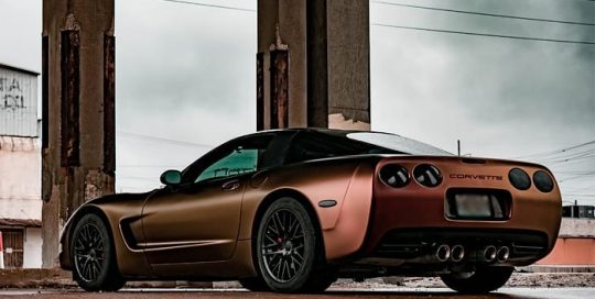 Chevrolet Corvette wrapped in Avery ColorFlow Satin Rising Sun Red/Gold shade shifting vinyl