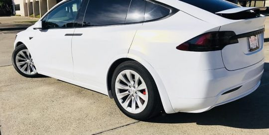 Tesla Model X wrapped in 3M 1080 Gloss White Gold Sparkle vinyl