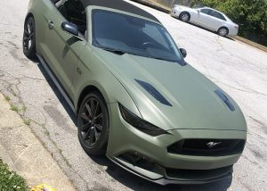 Ford Mustang wrapped in 3M 1080 Matte Military Green vinyl