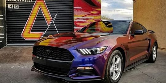 Ford Mustang wrapped in Avery ColorFlow Gloss Roaring Thunder Blue/Red shade shifting vinyl