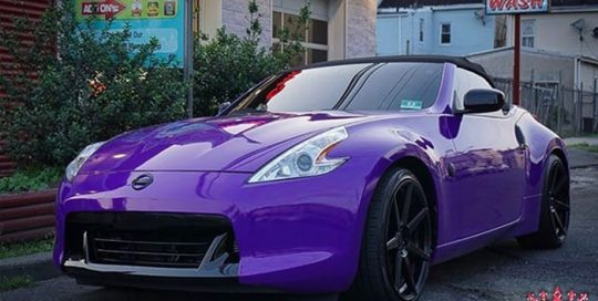 Nissan 370z wrapped in 3M 1080 Gloss Plum Explosion vinyl