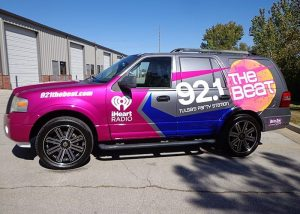 Ford Explorer wrapped in M 1080 Gloss Fierce Fuchsia, Blue Raspberry, and Anthracite, with custom printed IJ180C vinyls