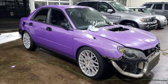 Subaru wrapped in Avery SW Diamond Purple vinyl