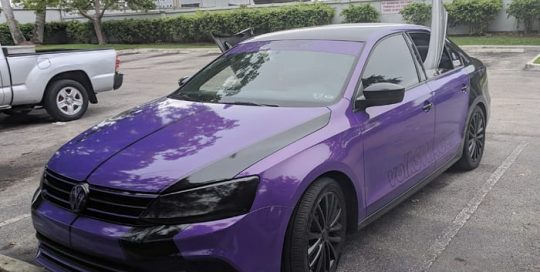 Volkswagen Jetta wrapped in 3M 1080 Gloss Plum Explosion vinyl
