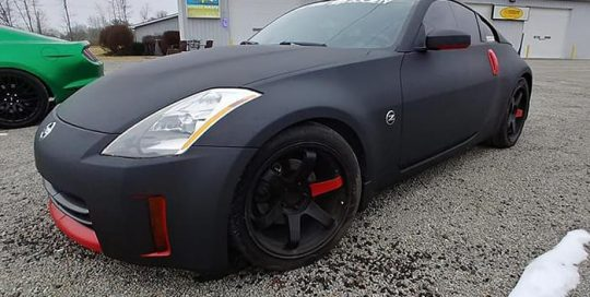 Nissan 350z wrapped in 3M 1080 Matte Deep Black vinyl