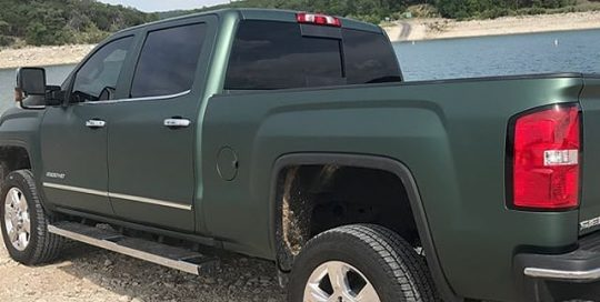 Gmc Sierra wrapped in 3M 1080 Matte Pine Green Metallic vinyl