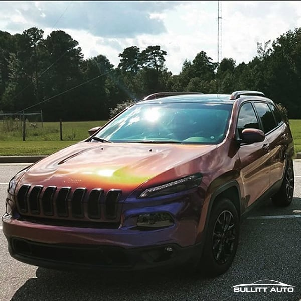 Jeep Cherokee wrapped in Avery ColorFlow Gloss Roaring Thunder Blue/Red shade shifting vinyl