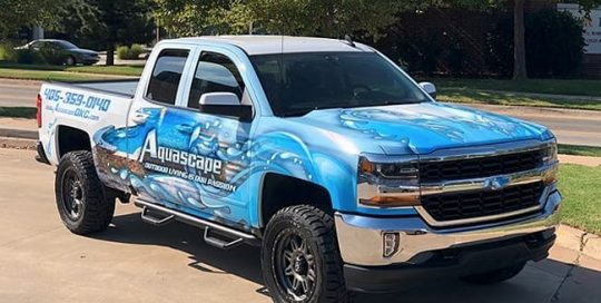 Chevrolet Silverado wrapped in printed Avery 1105 vinyl with 1360z Gloss