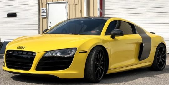 Audi R8 wrapped in 3M 1080 Gloss Bright Yellow vinyl