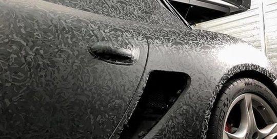 Porsche Cayman wrapped in 3M 1080 Shadow Black vinyl