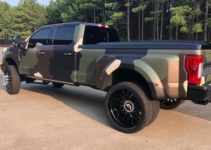 Ford F350 wrapped in M Matte Deep Black, Matte Military Green, Matte Brown Metallic, and Gloss Ivory with 8520 Matte Overlaminate vinyls