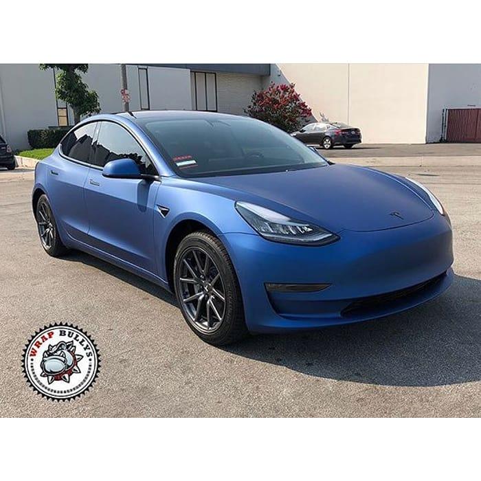 Tesla Model 3 wrapped in Avery SW Matte Blue Metallic vinyl