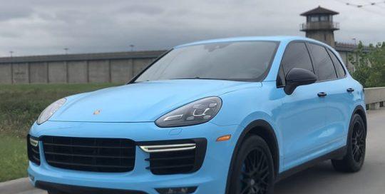Porsche Cayenne wrapped in 3M 1080 Gloss Sky Blue vinyl