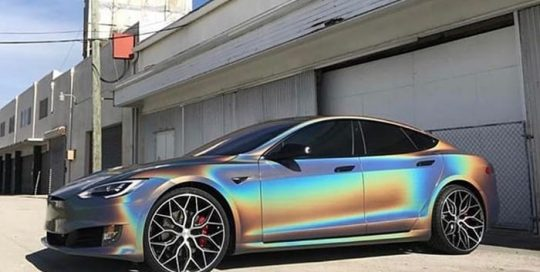 Tesla wrapped in 3M ColorFlip Gloss Psychedelic shade shifting vinyl