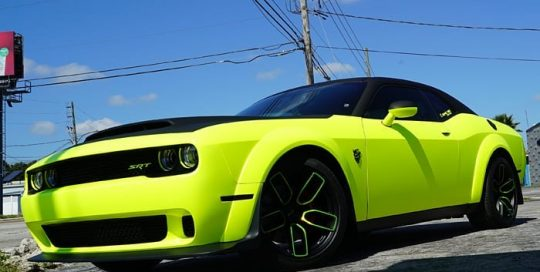 Dodge Challenger wrapped in 3M Satin Neon Fluorescent Yellow vinyl