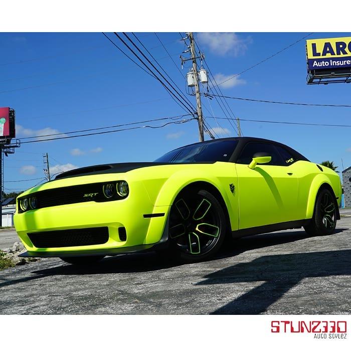 Dodge Challenger wrapped in 3M Satin Neon Fluorescent Yellow vinyl