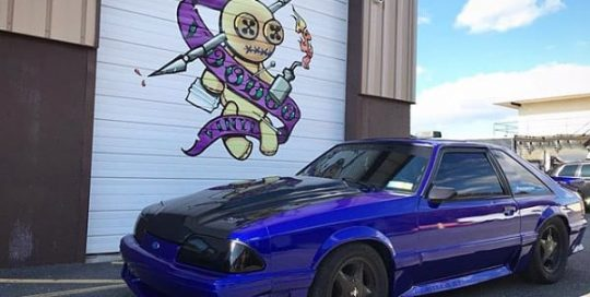 Ford Mustang wrapped in 3M 1080 Gloss Blue Raspberry vinyl