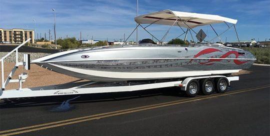 Boat wrapped in custom printed 3M IJ180mC-120 Metallic Satin White Aluminum vinyl