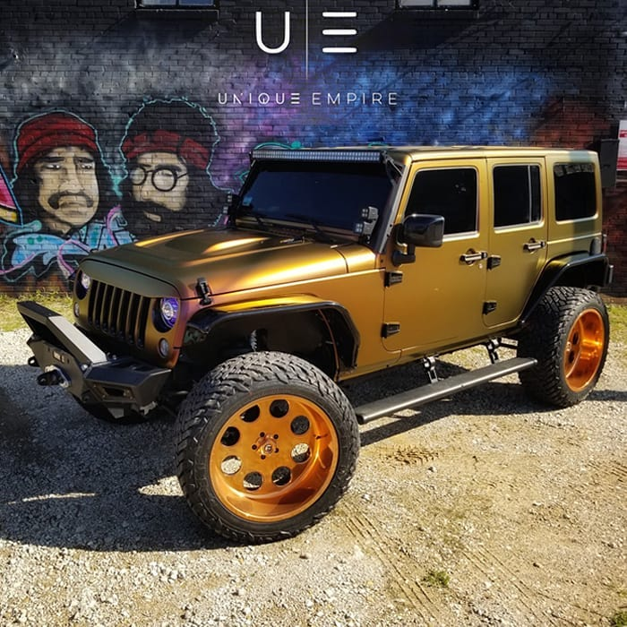 Jeep Wrangler wrapped in Avery ColorFlow Satin Rising Sun Red/Gold shade shifting vinyl
