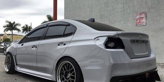Subaru STI wrapped in Avery SW Gloss Grey vinyl