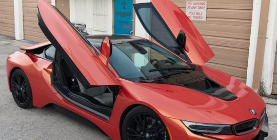 Bmw I8 wrapped in Orafol Shift Effect Gloss Sunset Shift Red/Orange shade shifting vinyl