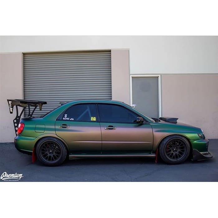 Subaru WRX wrapped in Avery Satin Urban Jungle Silver/Green/Purple shade shifting vinyl