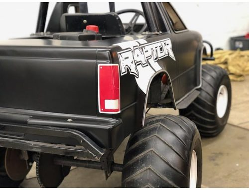 Ford Raptor wrapped in Avery SW Satin Black vinyl