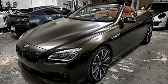 Bmw 650i wrapped in 3M 1080 Satin Gold Dust Black vinyl