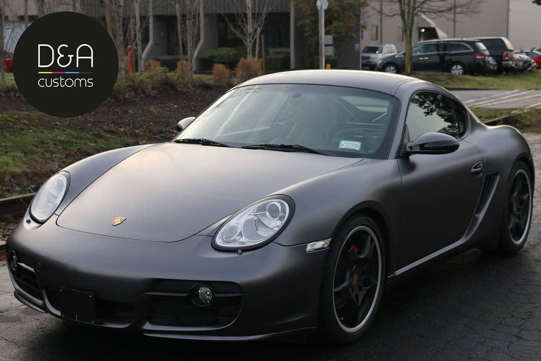 Porsche Cayman wrapped in 3M 1080 Satin Dark Gray vinyl