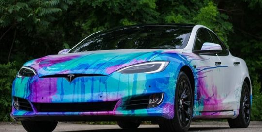 Tesla wrapped in custom printed Avery SW White Diamond vinyl