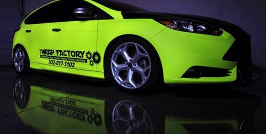 Ford Focus wrapped in Hi Liter (fluorescent) Yellow vinyl
