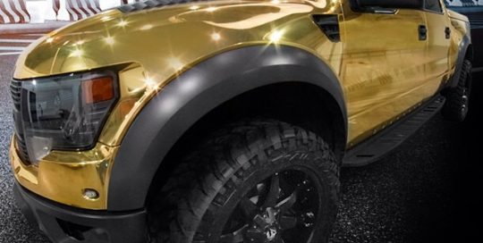 Ford Raptor Svt wrapped in Avery gold chrome vinyl!