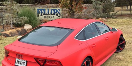 Audi RS7 wrapped in UPP F1 Matte Racing Red vinyl