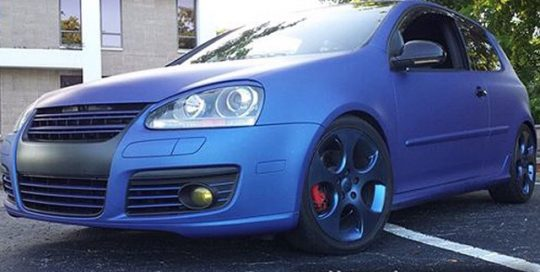 Volkswagen Golf Gti wrapped in Avery SWMatte Metallic Blue vinyl