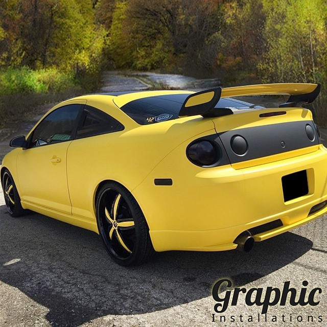 Chevrolet Cobalt wrapped in Matte Yellow and Matte Black