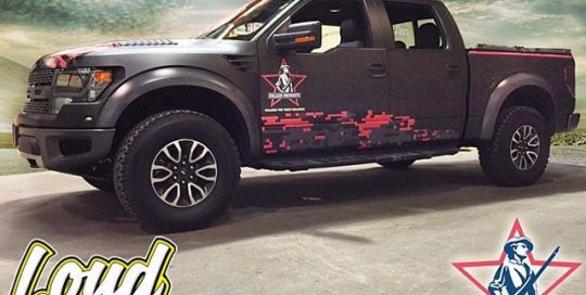 Ford Raptor wrapped in Matte Black vinyl and custom printing on IJ 480Cv3