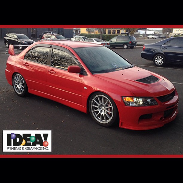 Mitsubishi Evolution wrapped in Avery Gloss Carmine Red