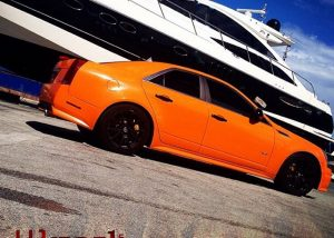 Cadillac CTVS wrapped in 970RA Municipal Orange vinyl