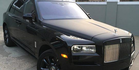 Rolls Royce Ghost wrapped in Gloss Black vinyl and hood wrapped in CheetahWrap Matte Black vinyl