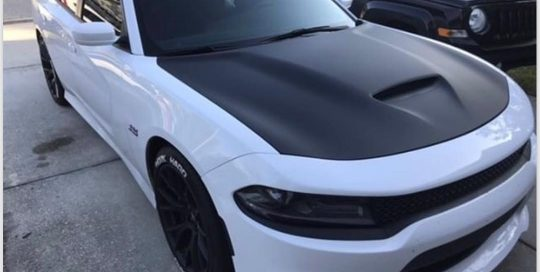 Dodge Charger wrapped in Matte Black vinyl