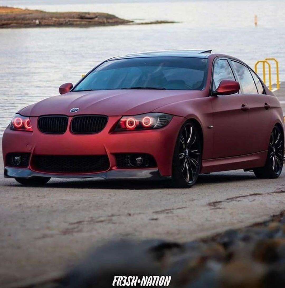 Bmw wrapped in Satin Red Aluminum vinyl