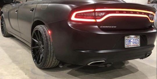 Dodge Charger wrapped in Satin Black vinyl