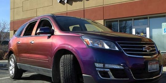 Chevrolet Traverse wrapped in Avery ColorFlow Gloss Rushing Riptide Cyan/Purple shade shifting vinyl