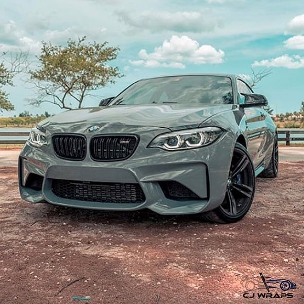 Bmw M2 wrapped in Avery SW Gloss Rock Grey vinyl
