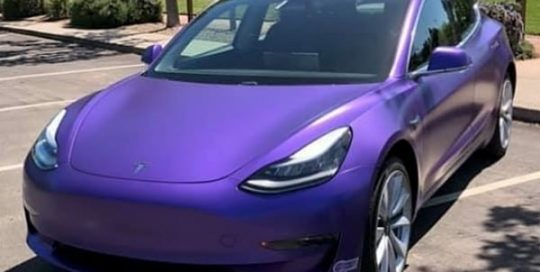 Tesla Model 3 wrapped in Avery Satin Purple Metallic vinyl