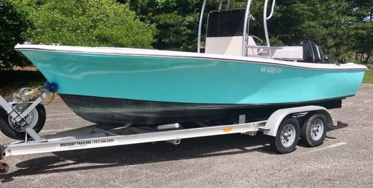 Boat wrapped in Gloss Mint Blue vinyl