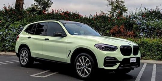 Bmw X3 wrapped in Avery SW Gloss Light Pistachio vinyl