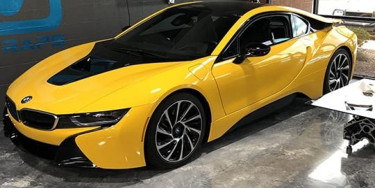 Bmw I8 wrapped in Avery SW Gloss Dark Yellow and Gloss Black vinyls