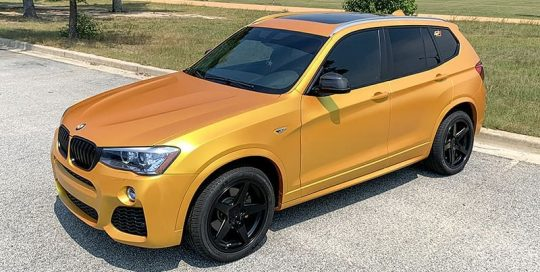 Bmw X3 wrapped in Avery SW Satin Metallic Energetic Yellow vinyl